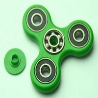 green ABS hand spinner with black rubber seals and ZrO2 ceramic balls