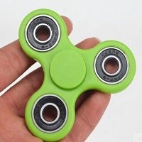 green ABS hand spinner with black rubber seals