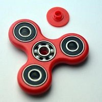 red ABS hand spinner with black rubber seals and ZrO2 ceramic balls